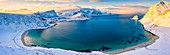 Aerial panoramic of Haukland beach covered with snow, Vestvagoy, Nordland, Lofoten Islands, Norway