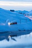 Turbine snowplow in action, Lago Bianco, Bernina Pass, Canton of Graubunden, Engadin, Switzerland