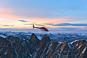 Aerial view of helicopter in flight on Pizzi Gemelli toward Piz Bernina, Valmalenco, Lombardy, border of Italy and Switzerland