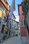 Rovinj - Rovigno, a narrow cobblestone street/alley in the old town, Istria, Adriatic coast, Croatia