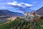 Grumello castle at dusk. Sondrio, Valtellina, Lombardy, Italy, Europe.