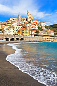 Waves break on the beach of Cervo village. Cervo, Imperia province, Liguria, Italy, Europe.