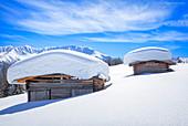 Typical alpine huts after a heavy snowfall. Wiesner Alp, Davos Wiesen, Landwasser Valley, Albula Valley, District of Prattigau/Davos, Canton of Graub?nden, Switzerland, Europe.