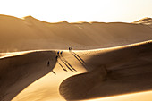 People have fun walking on a sand dune,Walvis Bay,Namibia,Africa