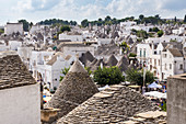 View of the rooftops of the typical Trulli huts of the old village of Alberobello. Province of Bari, Apulia, Italy, Europe.