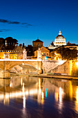 Rome at dusk with view of the dome of Saint Peter's Basilica, Octagonal Tower of the church of the holy spirit in the saxon district and Tiber River Europe, Italy, Lazio, Province of Rome, Rome, dusk