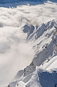 Clouds and mountain ridges from Feluma peak. Valgrisenche, Arvier, Valle d'Aosta, Italy.