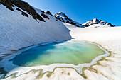 A mountain lake under Sforzellina Peak. Santa Caterina Valfurva, Gavia pass, Lombardy, Italy.