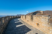The Great wall of China at Mutianyu section, seen through a vault. Huairou County, Beijing Municipality, People's Republic of China.