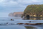 Rock formations at the Three Sisters. Tongaporutu, New Plymouth district. Taranaki region, North Island, New Zealand.