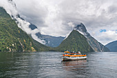 Touristic boat cruising in Milford Sound. Fiordland NP, Southland district, Southland region, South Island, New Zealand.