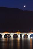 Azzone visconti bridge illuminate in the night, Lecco, Lombardy, Italy, Europe