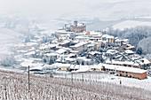 Langhe, Cuneo district, Piedmont, Italy. Langhe wine region winter snow, Barolo castle