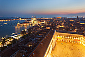 Santa Maria della Salute and St. Mark's Square seen from the top of St. Mark's Campanile at dusk, Venice, Veneto, Italy.