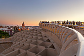 Tourists on the upper level of Metropol Parasol at sunset, Seville, province of Seville, Andalusia, Spain