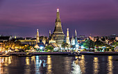 Wat Arun, a Buddhist temple in Bangkok, with nocturnal illumination, Thailand