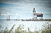 Lighthouse and sailboats, Marche island, Netherlands