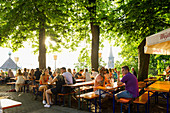 People in the beer garden and Freiburg Minster, sunset, Freiburg im Breisgau, Black Forest, Baden-Wurttemberg, Germany