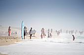 Surfers and bathers on the beach at coastal fog, Vieiie Saint Girons, French Atlantic coast, Aquitaine, France