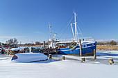 Wintry harbor in the fishing village Gothmund in winter, Baltic Sea coast, Schleswig-Holstein, Northern Germany