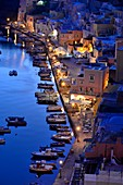 View of the small harbor of Corricella on the island of Procida, Gulf of Naples, Campania, Italy