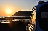 Sunset with Fiat 500 at Sant Angelo, Ischia island, Gulf of Naples, Campania, Italy