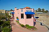 House near beach and footbridge in Capitola, California, USA