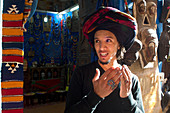 Young man with turban, Moroccan, Berber, stands in front of his business in Essaouira, Atlantic coast, Morocco