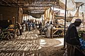 Men on the matte covered market in Rissani, Tafilalet, Morocco