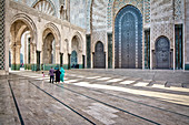 Courtyard in Hassan II Mosque with visitors, Casablanca, Morocco, Africa