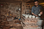 Workers in a pottery shop in the pottery town of Safi, Atlantic Coast, Morocco