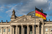 The Reichstag of Berlin with German flag, Berlin