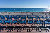 Blue chairs on the Promenade des Anglais, Cote d Azur, France