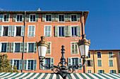 Typical facades at the flower market in the old town of Nice, France