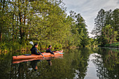 Water hiking by kayak through the UNESCO biosphere reserve Spreewald in Brandenburg,
