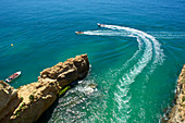 Boats off the cliff at Benagil, Algarve, Portugal