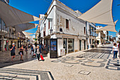 Pedestrian zone with awnings in Faro in bright sunshine, Algarve, Portugal