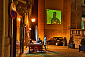 Bar in an alleyway with projection of a football game on a house wall, Guimarães, Minho, northern Portugal, Portugal