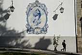 Picture of Mary in Azulejos with lamps and shadows at Jardim do Carmo, Guimarães, Minho, Northern Portugal