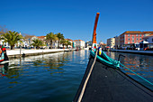 With a boat on the canal in Aveiro, Beira Litoral, Portugal,