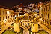 Fountain next to the covered market at night, Manga Cloister, Jardim da Manga, Coimbra, Beira, Central Portugal, Portugal