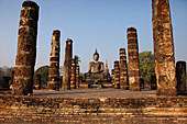 Sitting Buddha in the Historical Park of Sukhothai in the temple Wat Mahathat, ancient royal city, Sukhothai, Thailand