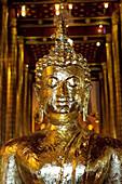 Golden Buddha statue in Wat Chedi Luang, Chiang Mai, Thailand