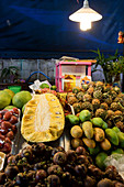 Fruit stand with, mangosteen, mangoes, jackfruit, pineapple and pomelo, Chiang Mai, Thailand