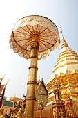 Golden stupa and screen in Buddhist temple Wat Prah. That Doi Suthep, Chiang Mai, Thailand
