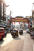 Road with tuk tuks to China Town in Chiang Mai, Chiang Mai, Thailand