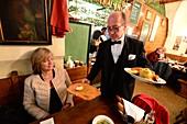 Ober served Riesenschnitzel in the restaurant Figlmüller, Vienna, Austria MR: Andrea Seifert