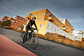 Young man on eBike in urban environment, Munich, Bavaria, Germany