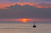 Trawler before the sunset on the sea, Sylt, North Sea, Schleswig-Holstein, Germany