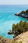 Bathers on Xigia sulfur beach with hot sulfur springs on the beach, Xigia bay, Zakynthos, Ionian islands, Greece